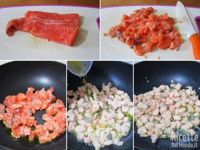 Tagliare a pezzi il salmone e rosolarlo